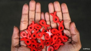 hands holding red ribbons