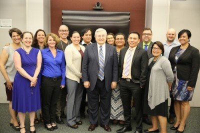 A group of 15 session attendees and IHS staff gathered for a photo in the conference room at the HHS Humphrey Building during the IHS Second Listening Session on American Indian and Alaska Native Lesbian, Gay, Bisexual, and Transgender Health Issues.