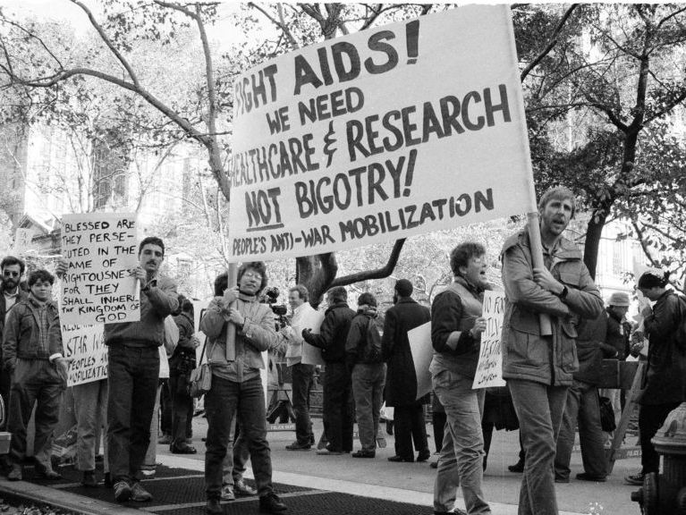 About 100 demonstrators protested on the steps of New York's City Hall on Friday, Nov. 15, 1985 as a City Council committee considered legislation to bar pupils and teachers with the AIDS virus from public schools. (AP Photo/Rick Maiman)