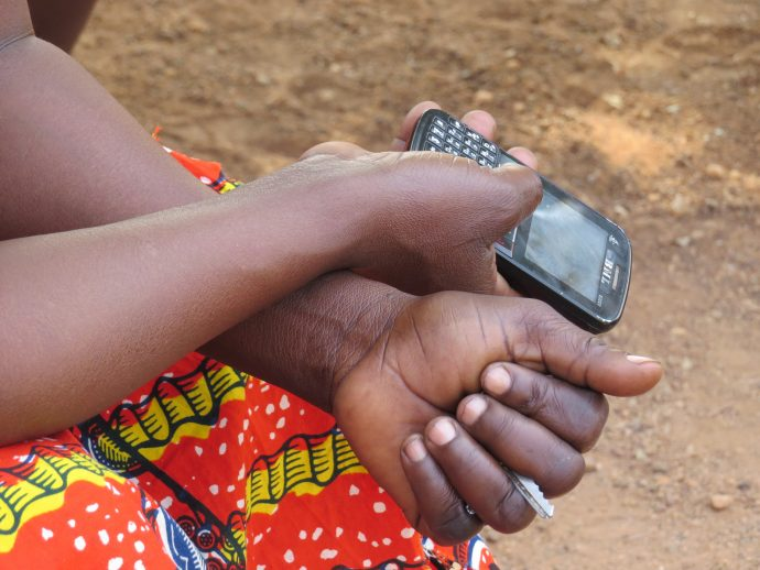 USAID blog - image 2 woman hand with phone - Jan 2017
