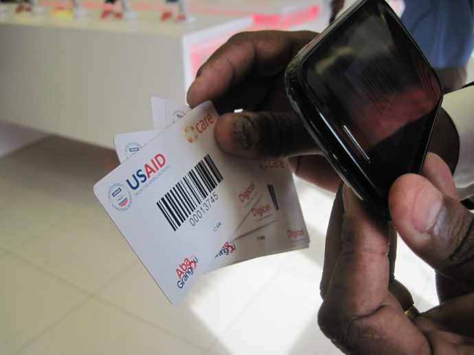 USAID blog - man hand with USAID cards - Jan 2017