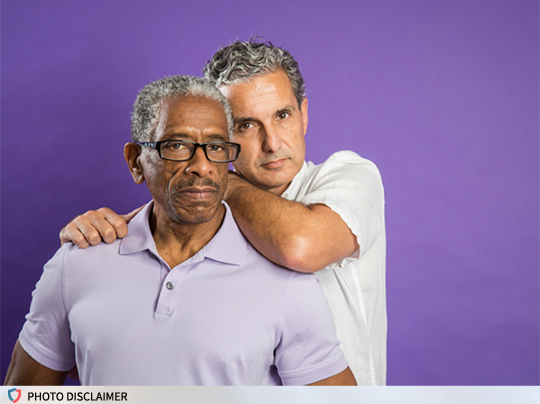 Photo of an older gay couple.