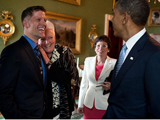 President Obama greets Grant Colfax and Gayle Smith of the National Security Council as Valerie Jarrett looks on.