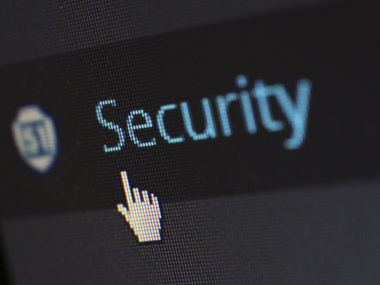 "Graphic showing computer screen and the word ""Security"""