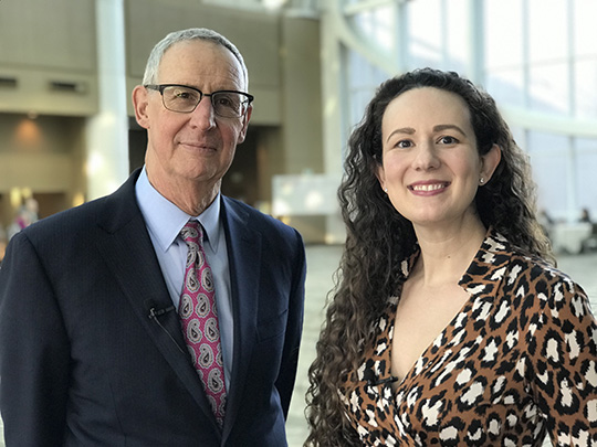 Photo of a woman and an posing together and smiling at the camera: Dr. Dieffenbach and his colleague Anne Rancourt