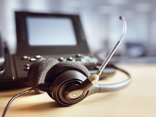 Photo of a computer and headphones