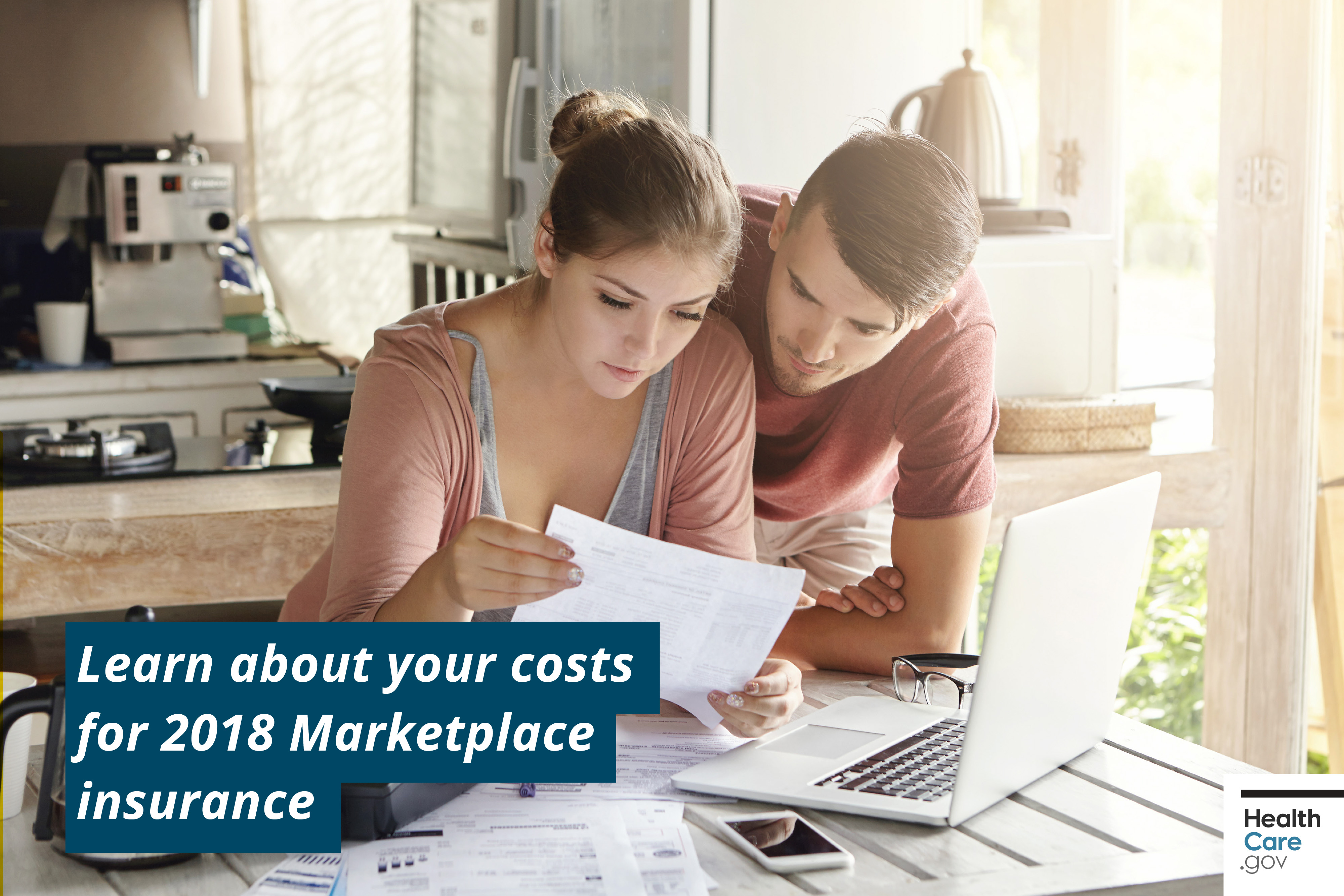 man and woman reviewing health plans