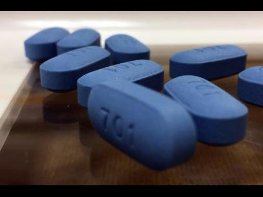 Several blue pills of PrEP