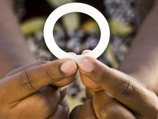 A woman holds a dapirivine ring in her hands.