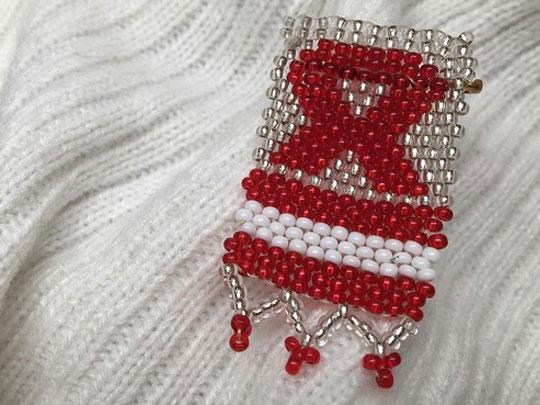 Beads in the shape of the AIDS ribbon