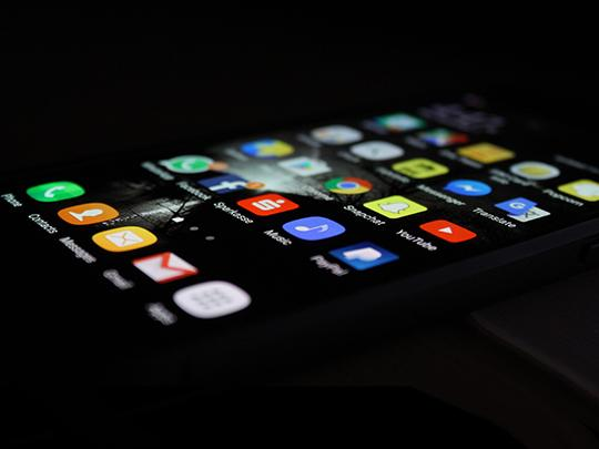 Close up image of a page of apps on a phone.