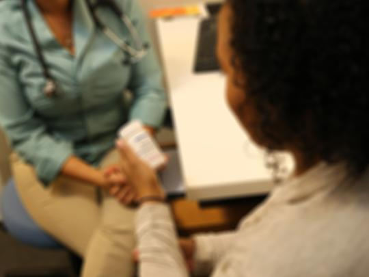 female-doctor-talking-to-patient-image-blurred-purposely