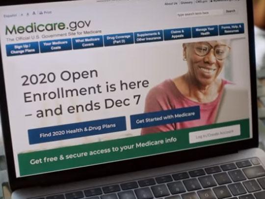 Screen grab from video of computer with Medicare.gov page on screen. 2020 Open enrollment is here. Ends Dec. 7.