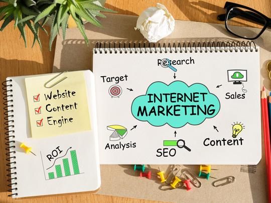 Graphic showing notebook with the words Internet Marketing